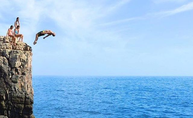 guy jumping of cliff